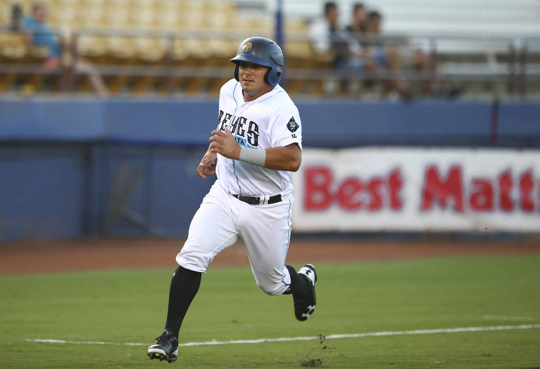 "Las Vegas 51s' Phillip Evans heads for first base to score a run off a double from Kevin Plawecki, not pictured, during the debut of the ""Reyes de Plata"" (Silver Kings), part of  ..."