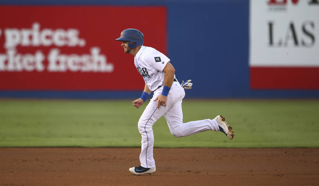 "Las Vegas 51s' Kevin Plawecki runs for third base during the debut of the ""Reyes de Plata"" (Silver Kings), part of a new Minor League Baseball initiative, during a baseball game  ..."