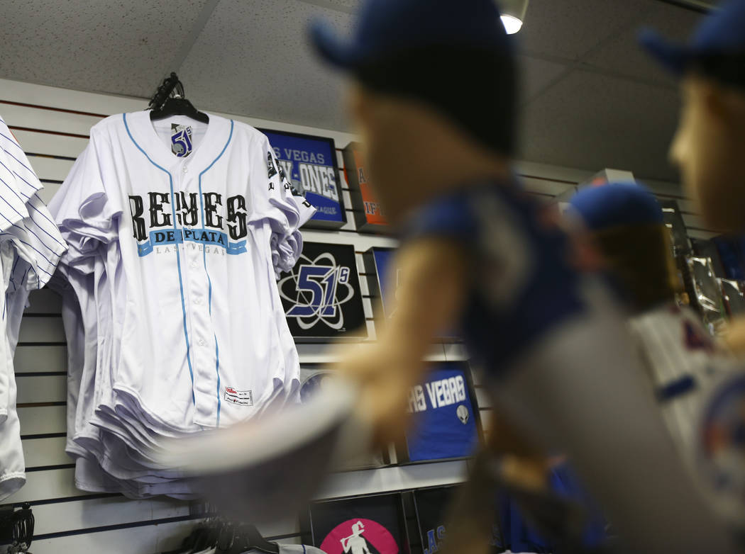 "Jerseys featuring the special Las Vegas 51s ""Reyes de Plata"" (Silver Kings) name, part of a new Minor League Baseball initiative, are displayed at the team store at Cashman Field ..."