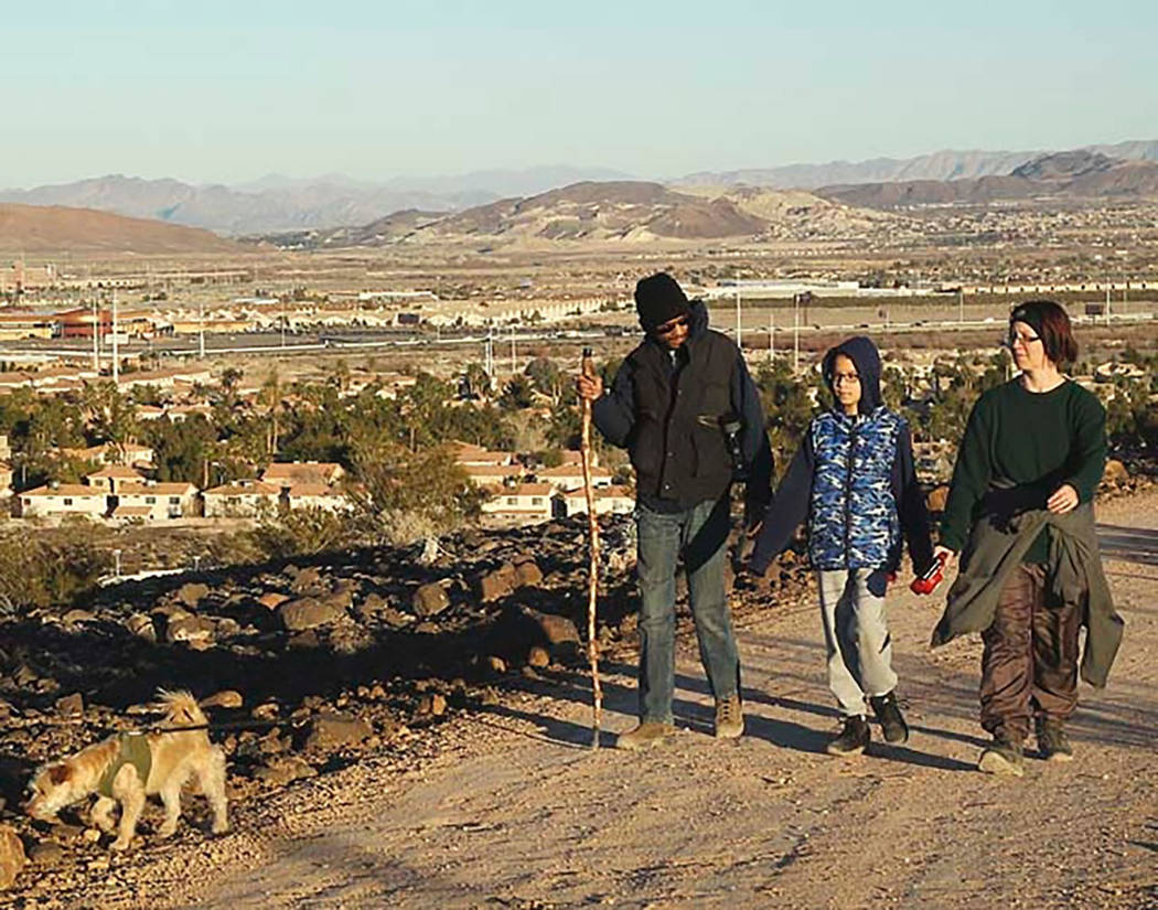 From left, Sammie, Nathan, and Kristie King take a walk during sunset on the Upper Mesa Trail at the Whitney Mesa Recreation Area in Henderson in an undated photo. (Las Vegas Review-Journal)