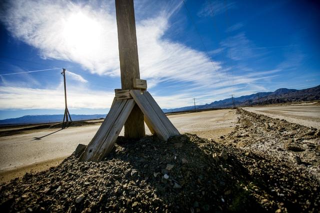 Transmissions lines sit on a  lithium brining pond near  Silver Peak, Nev. is seen on Friday, Nov. 21,2015.  (Jeff Scheid/Las Vegas Review-Journal) @jlscheid