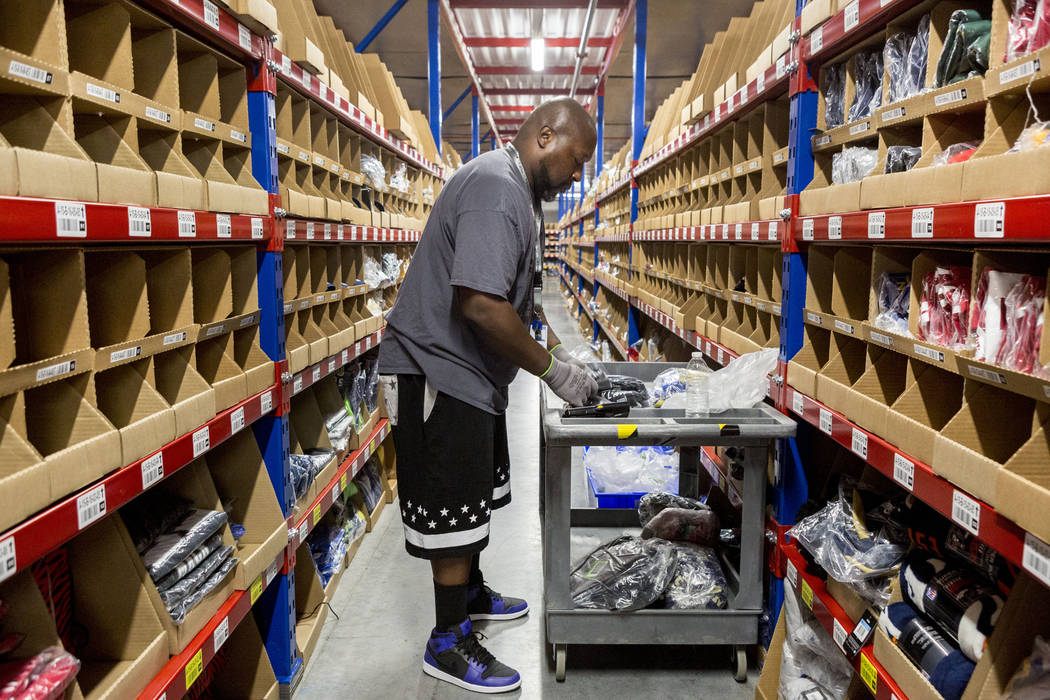 Warehouse employee Charles Williams organizes apparel at the Fanatics distribution center in North Las Vegas, Wednesday, Aug. 16, 2017. (Elizabeth Brumley/Las Vegas Review-Journal)