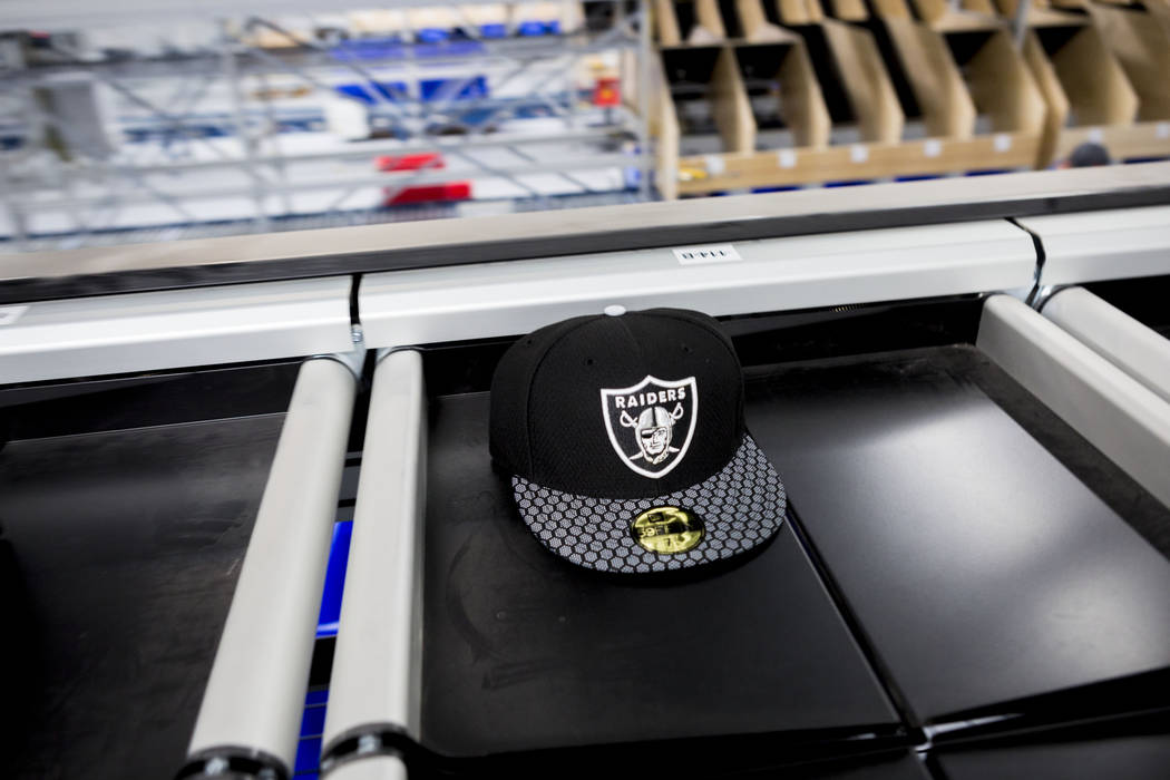 An athletic logo hat on a conveyer belt at the Fanatics distribution center in North Las Vegas, Wednesday, Aug. 16, 2017. (Elizabeth Brumley/Las Vegas Review-Journal)