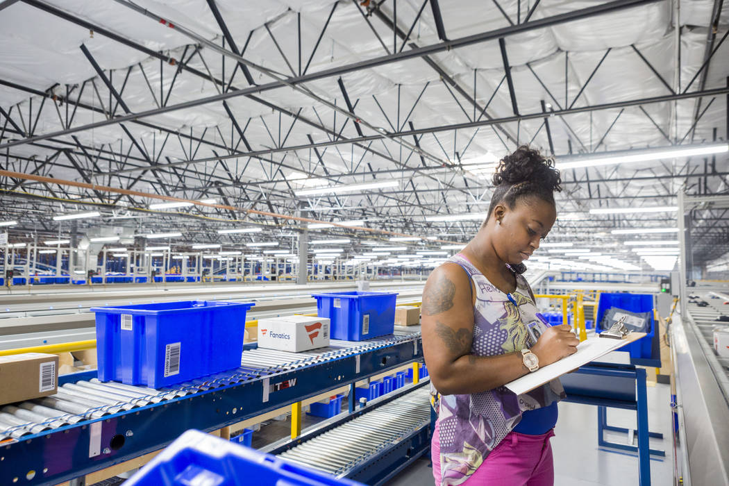 Shipping lead Olivia McCantis takes inventory at the Fanatics distribution center in North Las Vegas, Wednesday, Aug. 16, 2017. (Elizabeth Brumley/Las Vegas Review-Journal)