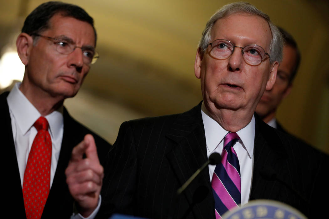 Senate Majority Leader Mitch McConnell, accompanied by Senator John Barrasso (R-WY), speaks with reporters following the party luncheons on Capitol Hill in Washington, U.S., August 1, 2017. REUTER ...