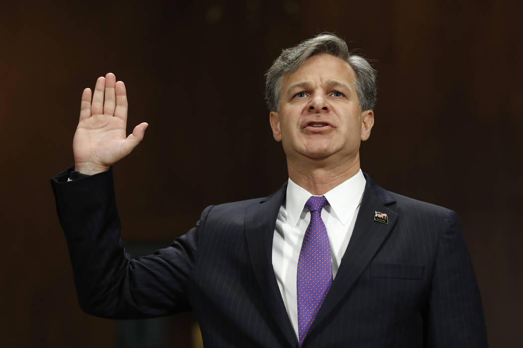 FBI director nominee Christopher Wray is sworn-on on Capitol Hill in Washington, Wednesday, July 12, 2017, prior to testifying at his confirmation hearing before the Senate Judiciary Committee. Th ...