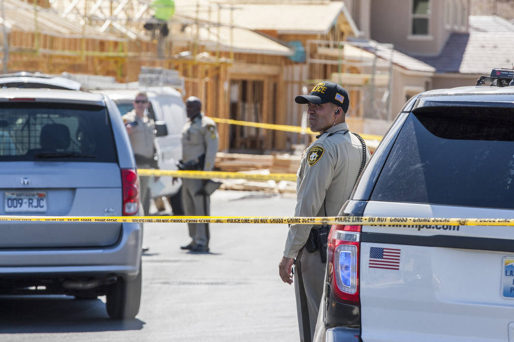 Police congregate at a crime scene where a child shot themself on Chandler Springs Avenue in southwest Las Vegas on Tuesday, August 1, 2017.  Patrick Connolly Las Vegas Review-Journal @PConnPie