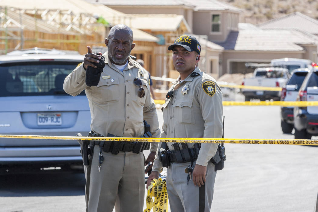 Metro police officers plan to expand the crime scene where a child shot themself on Chandler Springs Avenue in southwest Las Vegas on Tuesday, August 1, 2017.  Patrick Connolly Las Vegas Review-Jo ...