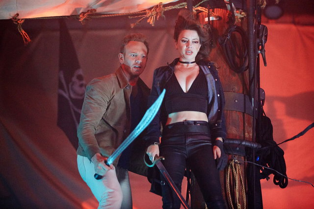 "Ian Ziering as Fin Shepard and Masiela Lusha as Gemini sail the Treasure Island pirate ship down a flooded Strip in a scene from ""SHARKNADO: THE 4TH AWAKENS.""(Tyler Golden/Syfy)"