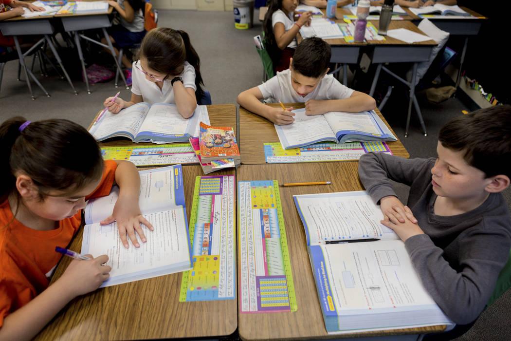 Student's in Amy Bennett's third grade classroom work on mathematics at Vanderburg Elementary in Henderson, Wednesday, April 19, 2017. Elizabeth Brumley Las Vegas Review-Journal @EliPagePhoto
