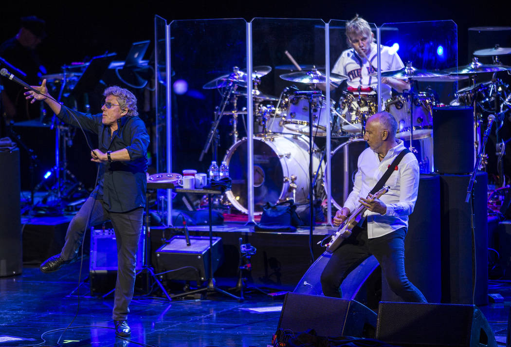 Roger Daltrey attempts to catch the microphone while guitarist Pete Townshend watches while The Who performs at the Colosseum at Caesars Palace on Saturday, July 29, 2017.  Patrick Connolly Las Ve ...