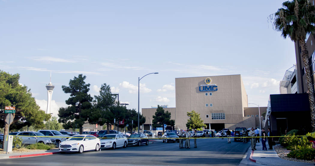 Police officers gather in front of University Medical Center to support the injured Metro officer, Tuesday, August 1, 2017, after an officer-involved shooting at the intersection of Tompkins Avenu ...