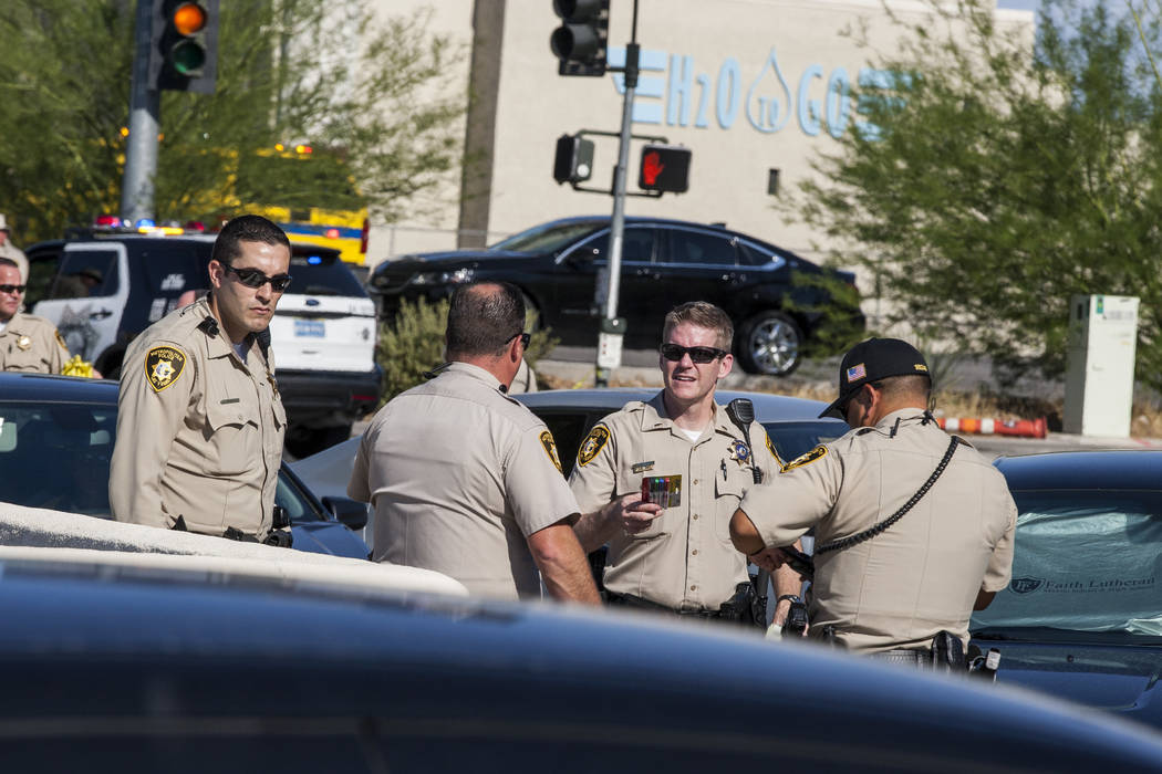 Police congregate near the intersection of Tompkins Avenue and Arville Street after an officer-involved shooting in which an officer was injured on Tuesday, August 1, 2017.  Patrick Connolly Las V ...