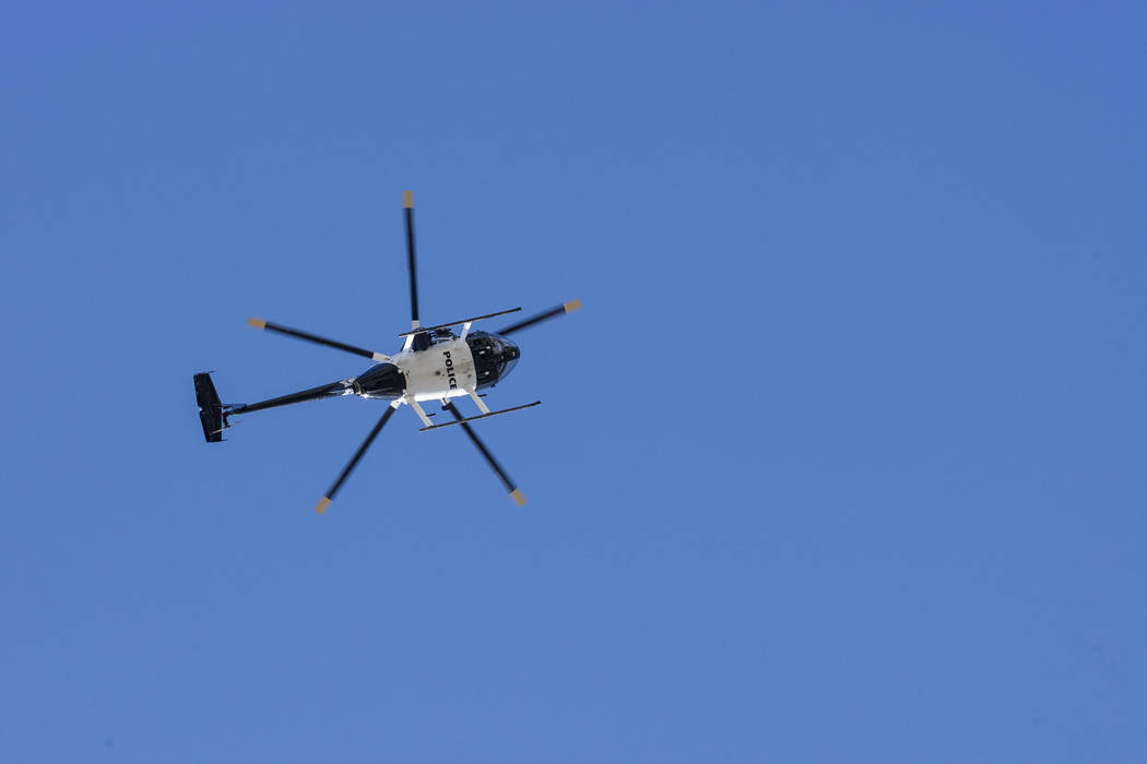 A police helicopter flies over the intersection Tompkins Avenue and Arville Street after an officer-involved shooting in which an officer was injured on Tuesday, August 1, 2017.  Patrick Connolly  ...