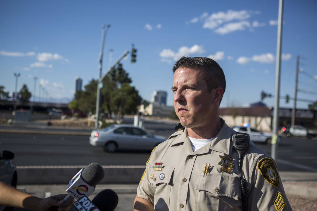Sgt. Jeff Clark gives a briefing at the intersection Tropicana Avenue and Arville Street after an officer-involved shooting in which an officer was injured on Tuesday, August 1, 2017. Clark said t ...
