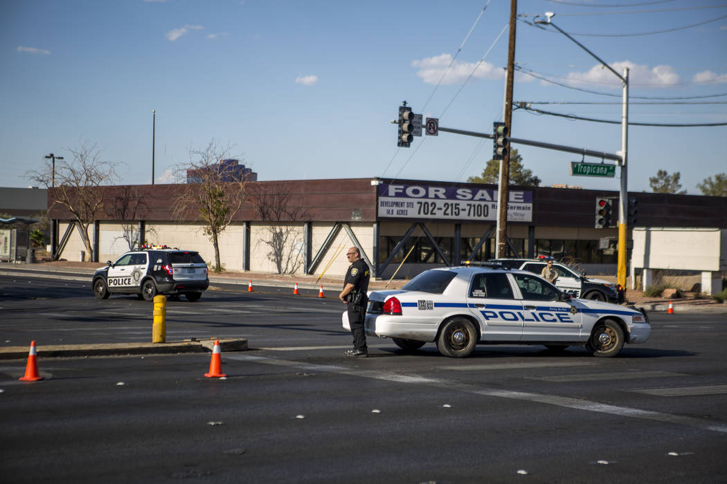 Police block off the intersection of Tropicana Avenue and Arville Street after an officer-involved shooting in which an officer was injured on Tuesday, August 1, 2017.  Patrick Connolly Las Vegas  ...