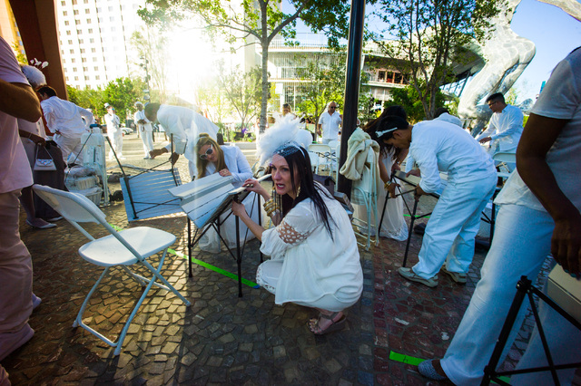 Attendees get set up at the Diner en Blanc pop-up picnic event at The Park in Las Vegas on Sunday, April 17, 2016. Chase Stevens/Las Vegas Review-Journal Follow @csstevensphoto