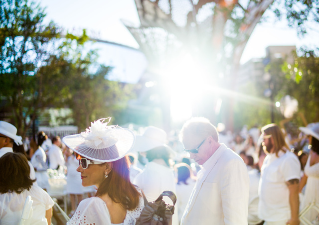 Attendees arrive to the Diner en Blanc pop-up picnic event at The Park in Las Vegas on Sunday, April 17, 2016. Chase Stevens/Las Vegas Review-Journal Follow @csstevensphoto