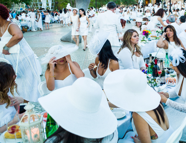 Attendees mingle during the Diner en Blanc pop-up picnic event at The Park in Las Vegas on Sunday, April 17, 2016. Chase Stevens/Las Vegas Review-Journal Follow @csstevensphoto