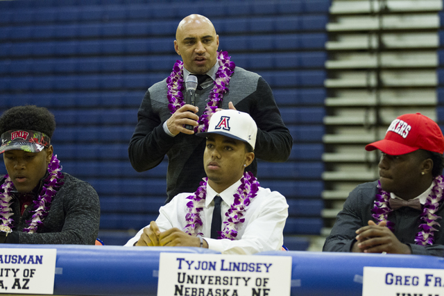 Bishop Gorman football head coach Kenny Sanchez speaks during Signing Day, with his players from left, Farrell Hester, Malik Hausman, and Tyjon Lindsey, at Bishop Gorman High School on Wednesday,  ...