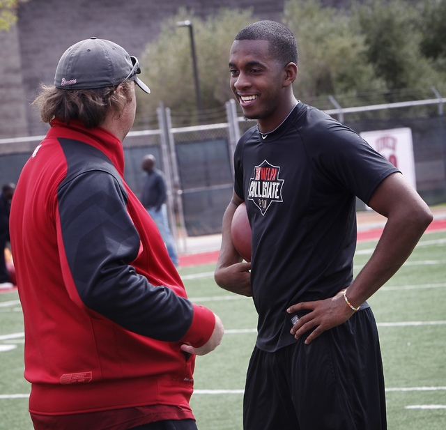 Former UNLV starting quarterback Caleb Herring, right, talks with Arizona Cardinals' quarterback coach Freddie Kitchens during his pro day audition at UNLV on Thursday, March 13, 2014. (Jason Bean ...