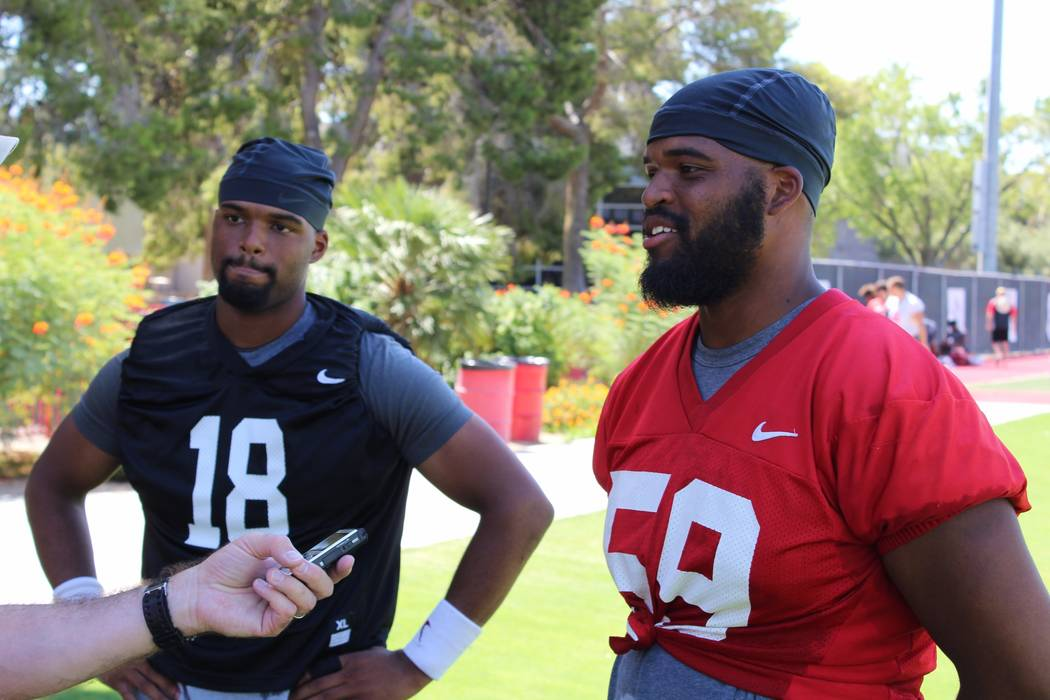 Twins Rasheem, left, and Rasheed Parks are on opposite sides of the football. Rasheem is a quarterback at UNLV and Rasheed a defensive lineman. Photo courtesy of UNLV Athletics.