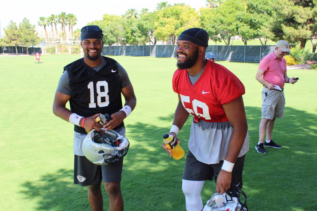 Twins Rasheem, left, and Rasheed Parks share a laugh after Friday's UNLV football practice at Rebel Park. Photo courtesy of UNLV Athletics.
