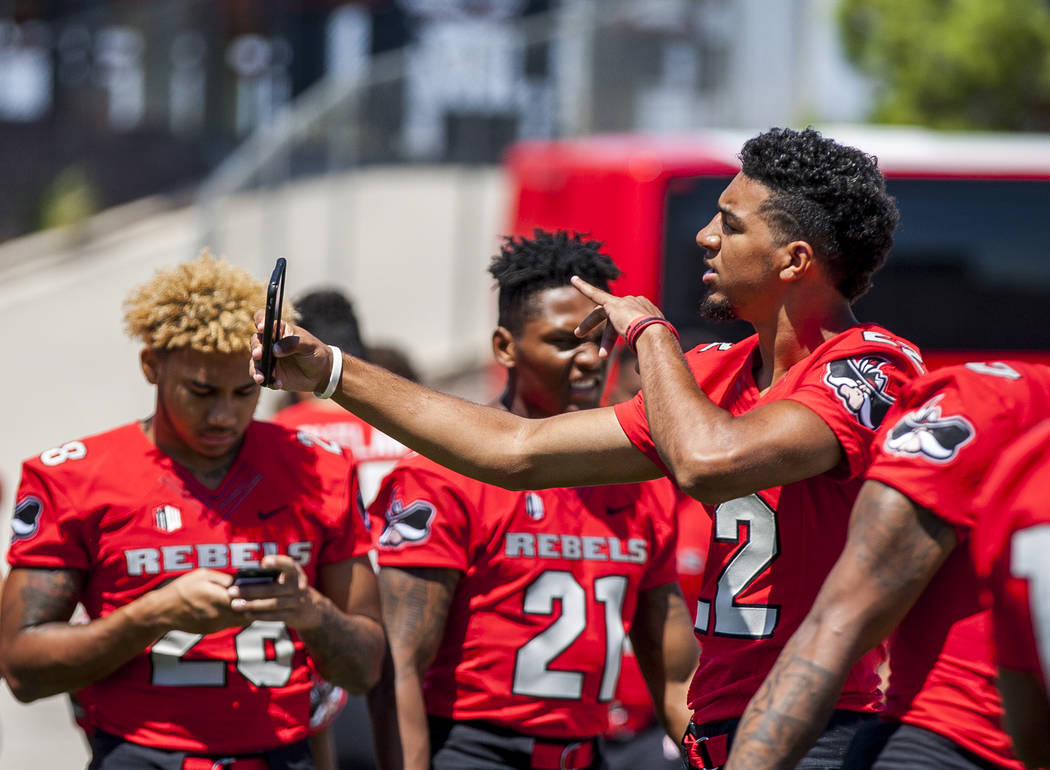 UNLV defensive back Demitrious Gibbs takes a selfie during photo day at Sam Boyd Stadium on Monday, Aug. 7, 2017.  Patrick Connolly Las Vegas Review-Journal @PConnPie
