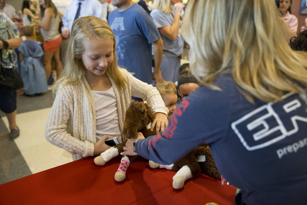 Elizabeth Downing, 9, with her stuffed animal after getting bandaged during the Teddy Bear Clinic at Centennial Hills Hospital in Las Vegas on Wednesday, Aug. 2, 2017. Erik Verduzco Las Vegas Revi ...