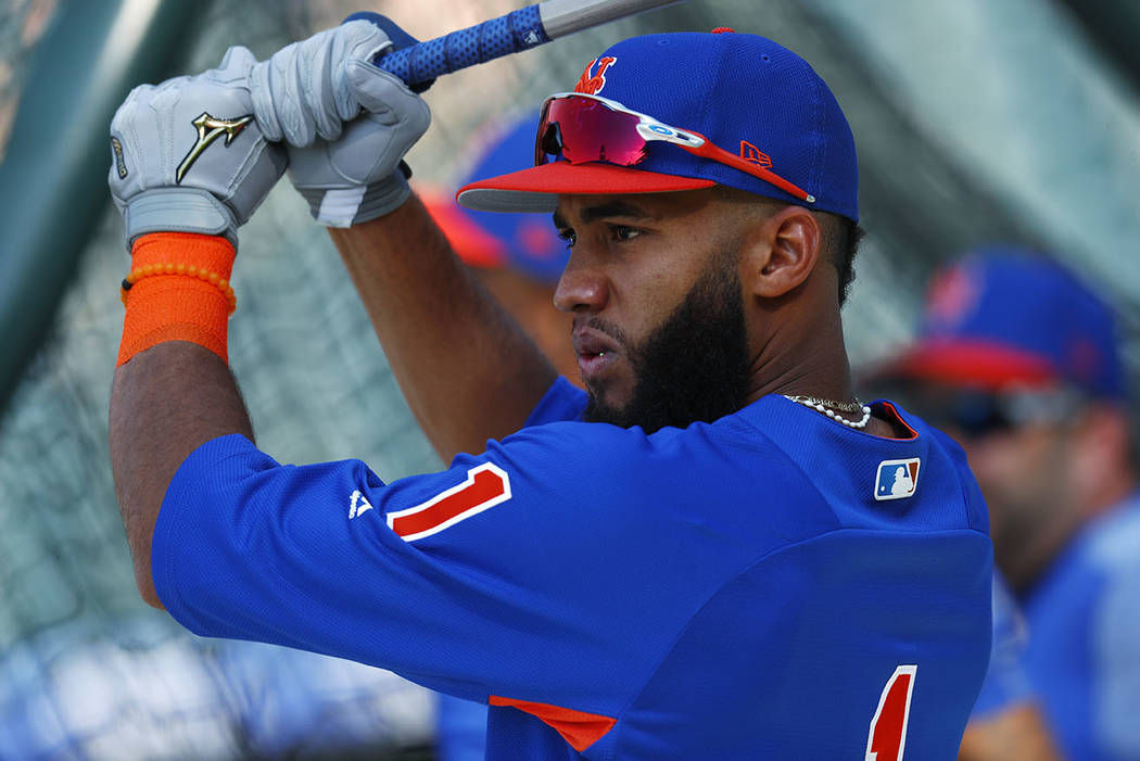 New York Mets shortstop Amed Rosario waits for his turn in the cage during batting practice for the team's baseball game against the Colorado Rockies on Tuesday, Aug. 1, 2017, Denver. (AP Photo/Da ...