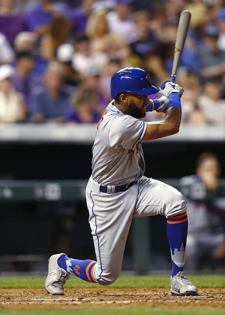 New York Mets' Amed Rosario follows through on a single off Colorado Rockies relief pitcher Scott Oberg during the eighth inning of a baseball game Tuesday, Aug. 1, 2017, Denver. The Rockies won 5 ...