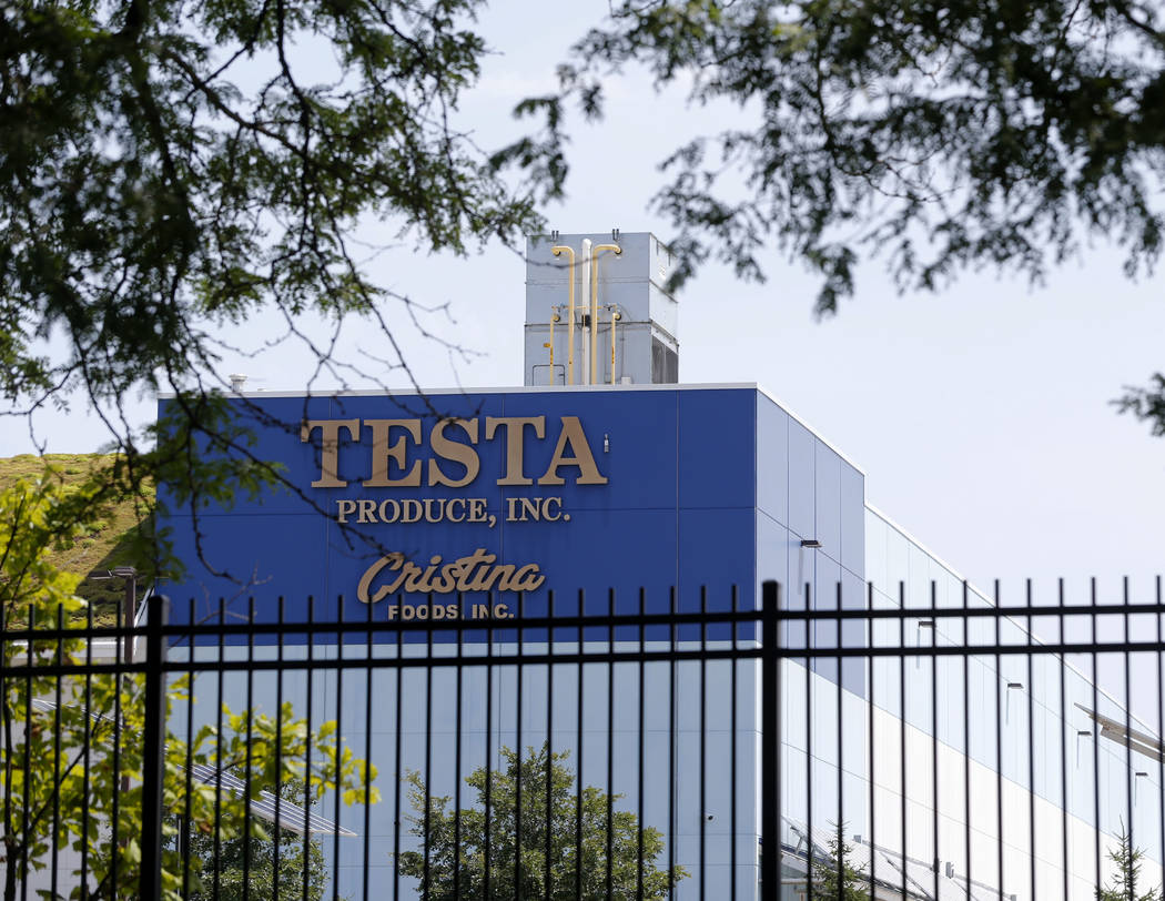 In this photo taken July 20, 2017, the Testa Produce Inc. plant on the South Side of Chicago. Older people are dying on the job at a higher rate than workers overall, even as the rate of workplace ...