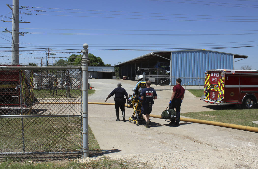 In this photo provide by the Bryan, Texas Fire Department, taken April 29, 2014, Bryan Texas firefighters transport injured worker in a stretcher to the ambulance. An explosion at the Bryan Texas  ...