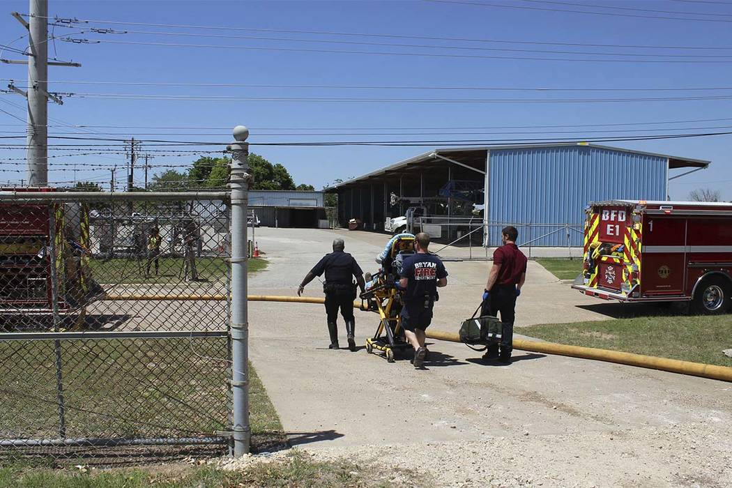 Bryan Texas firefighters transport an injured worker to the ambulance after a deadly explosion at the Bryan Texas Utilities Power Plant left a 60-year-old employee dead and two injured. (Bryan, Te ...