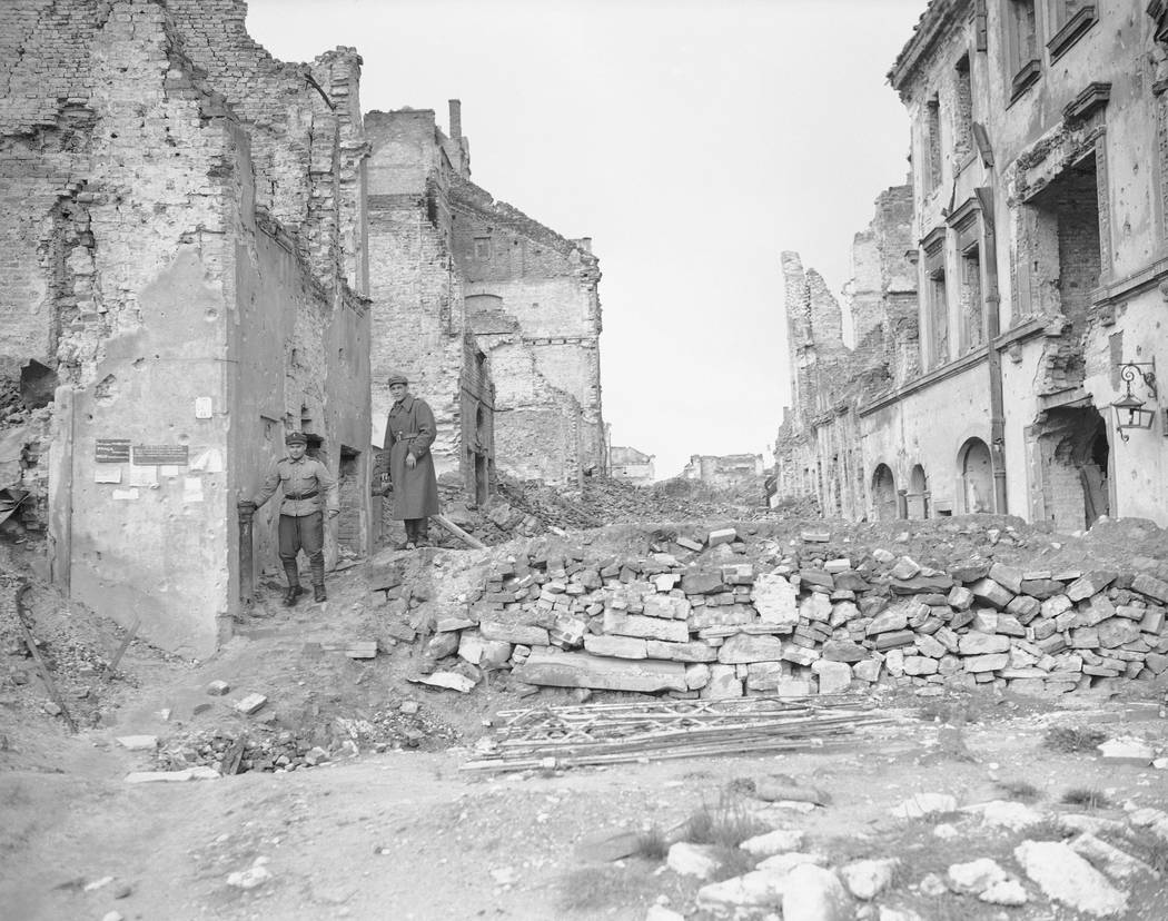 File-this file photo from 1945 shows two German soldiers make their way through the gutted city of Warsaw, the capital of Poland, in September 1945. A Polish ruling party official said Wednesday t ...