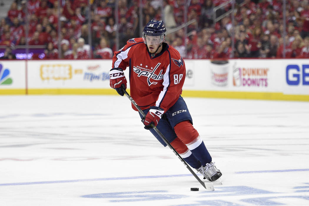 Nate Schmidt (88) skates with the puck during the second period of Game 2 in an NHL hockey Stanley Cup second-round playoff series against the Pittsburgh Penguins, Saturday, April 29, 2017, in Was ...