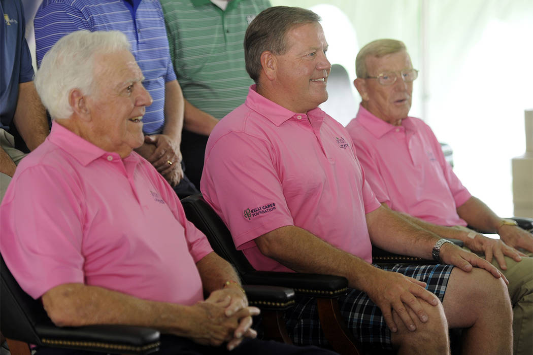 From left, Former Notre Dame football coach Ara Parsgehian, current Brian Kelly, and former coach Lou Holtz smile for a photo at the Legends golf outing in Bridgman, Michigan, Tuesday June 12, 201 ...