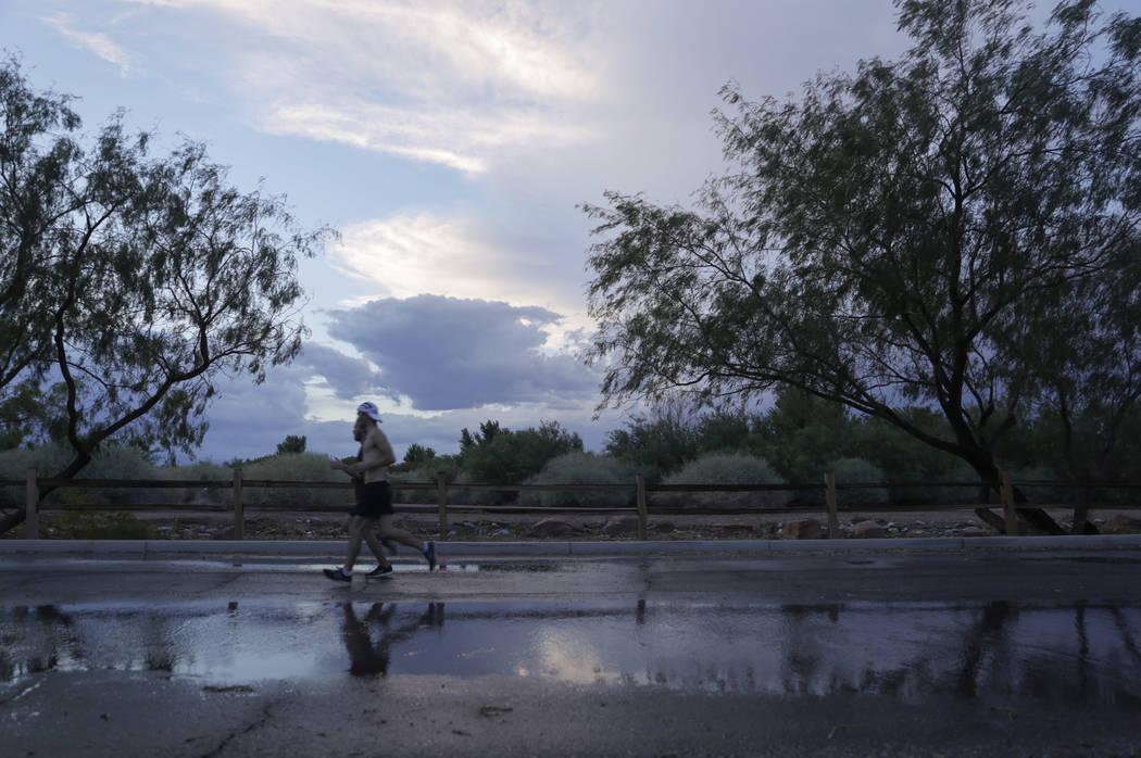 Runners jog after a storm passes through Clark County Wetlands Park in Las Vegas, Wednesday, Aug. 2, 2017. Gabriella Angotti-Jones Las Vegas Review-Journal @gabriellaangojo