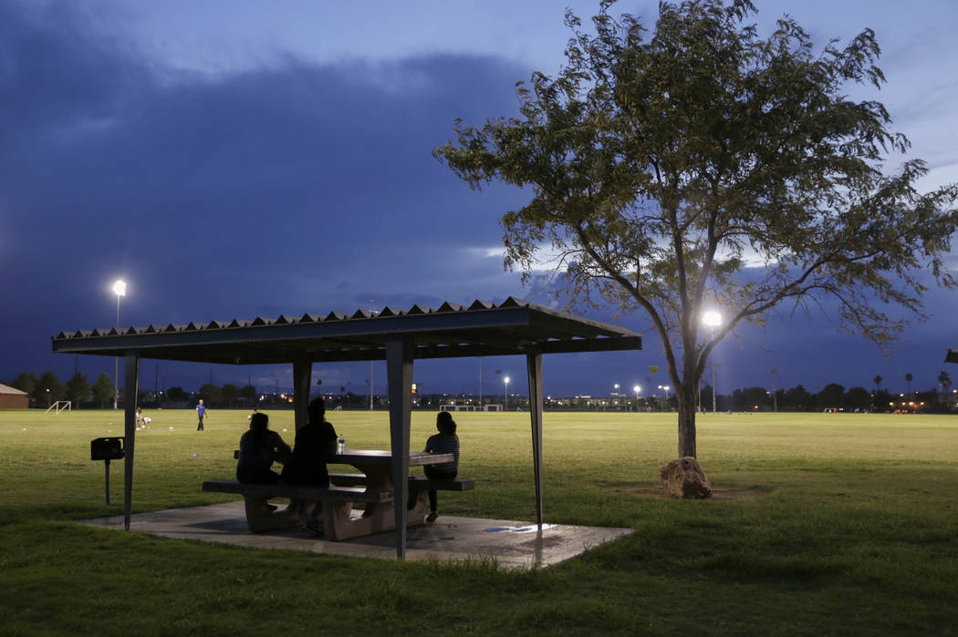 People hang out at Russell Road Recreation Complex as a storm passes overhead in Henderson, Wednesday, Aug. 2, 2017. Gabriella Angotti-Jones Las Vegas Review-Journal @gabriellaangojo