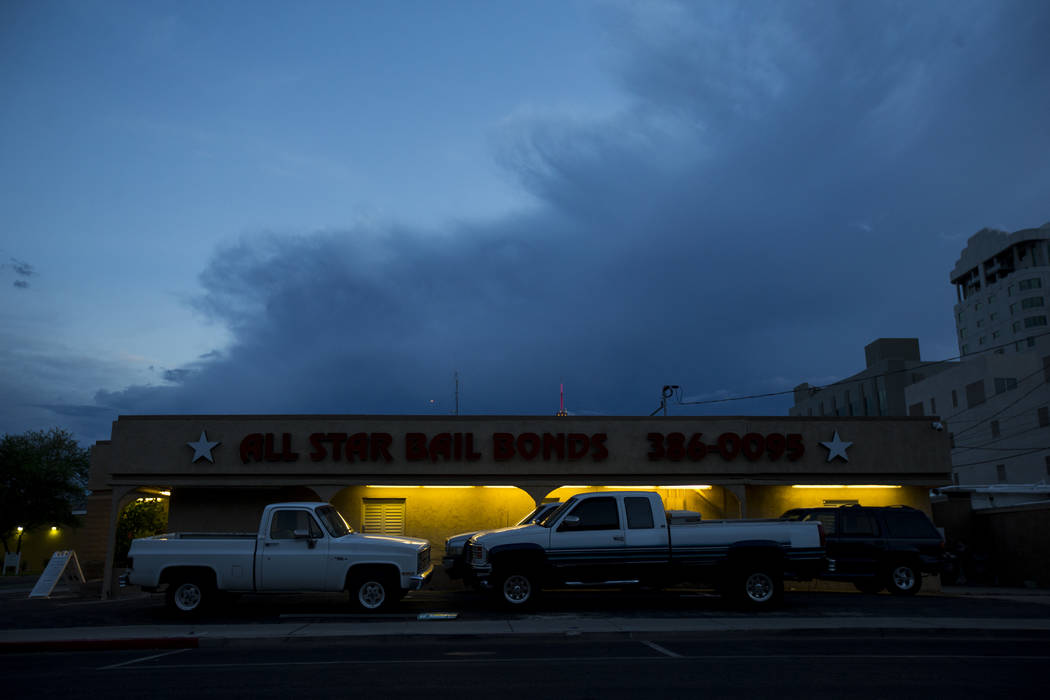 Light on a building contrasts against the sky at dusk in downtown Las Vegas on Wednesday, Aug. 2, 2017. Chase Stevens Las Vegas Review-Journal @csstevensphoto