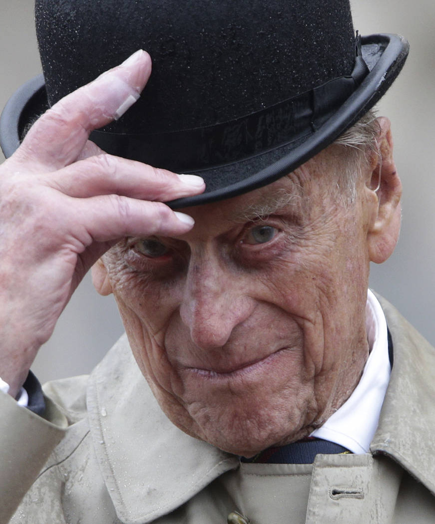 Britain's Prince Philip, in his role as Captain General of the Royal Marines, attends a Parade on the forecourt of Buckingham Palace, in central London, as it rains Wednesday Aug. 2, 2017.  The 96 ...