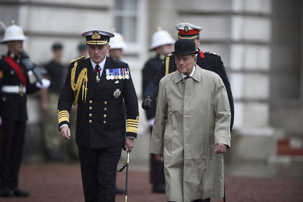 Britain's Prince Philip, right, in his role as Captain General of the Royal Marines, attends a Parade on the forecourt of Buckingham Palace, in central London, Wednesday Aug. 2, 2017.  The 96-year ...