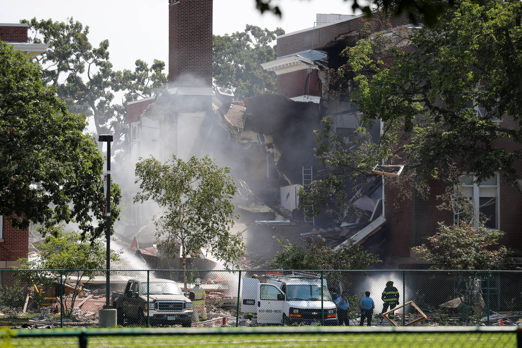 Emergency personnel put water on the scene of school building collapse at Minnehaha Academy in Minneapolis, Minnesota, U.S., August 2, 2017. (Adam Bettcher/Reuters)