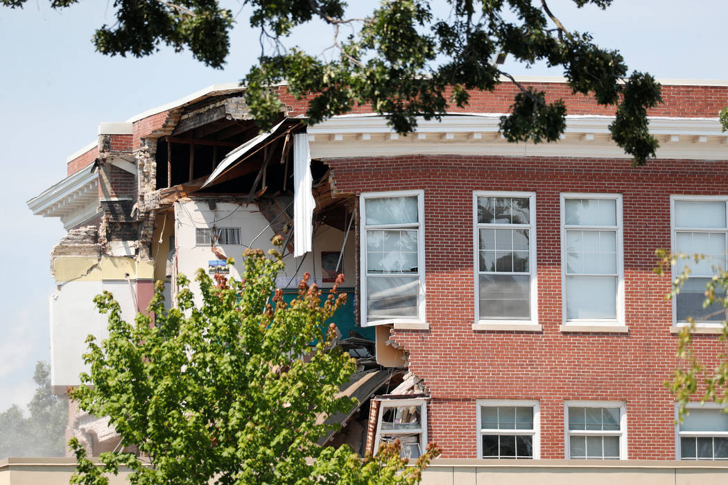 Damage to the building is seen as emergency personnel work the scene of school building collapse at Minnehaha Academy in Minneapolis, Minnesota, U.S., August 2, 2017. (Adam Bettcher/Reuters)