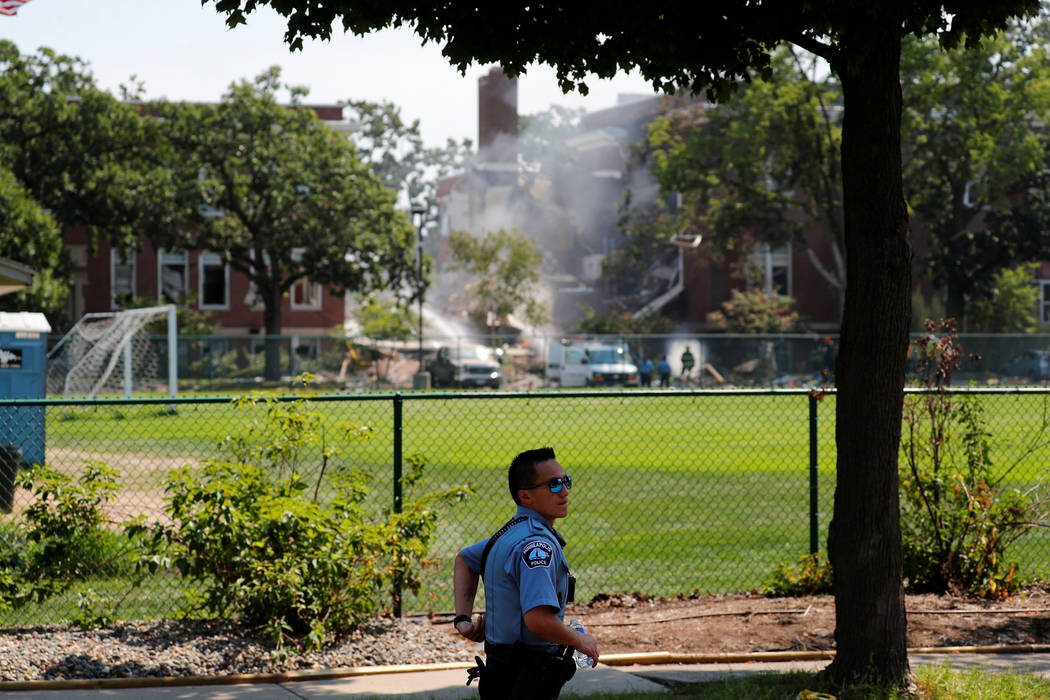 Emergency personnel work the scene of a school building collapse at Minnehaha Academy in Minneapolis, Minnesota, U.S., August 2, 2017. (Adam Bettcher/Reuters)