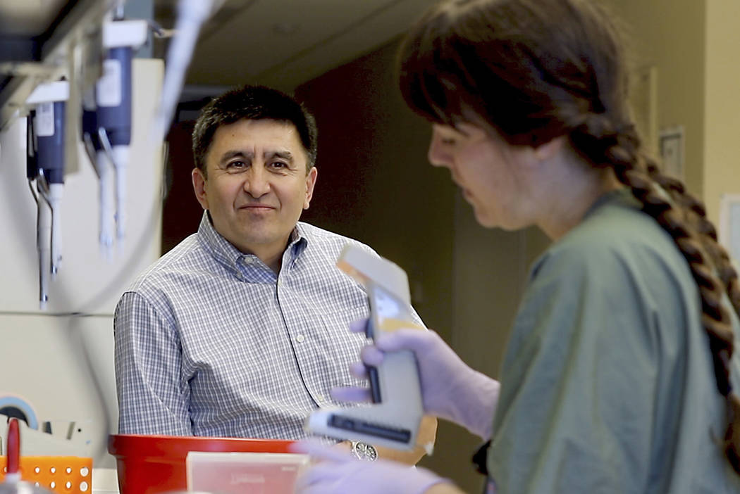 Shoukhrat Mitalipov, left, talks with research assistant Hayley Darby in the Mitalipov Lab at OHSU in Portland, Ore. on July 31, 2017. Mitalipov led a research team that, for the first time, used  ...
