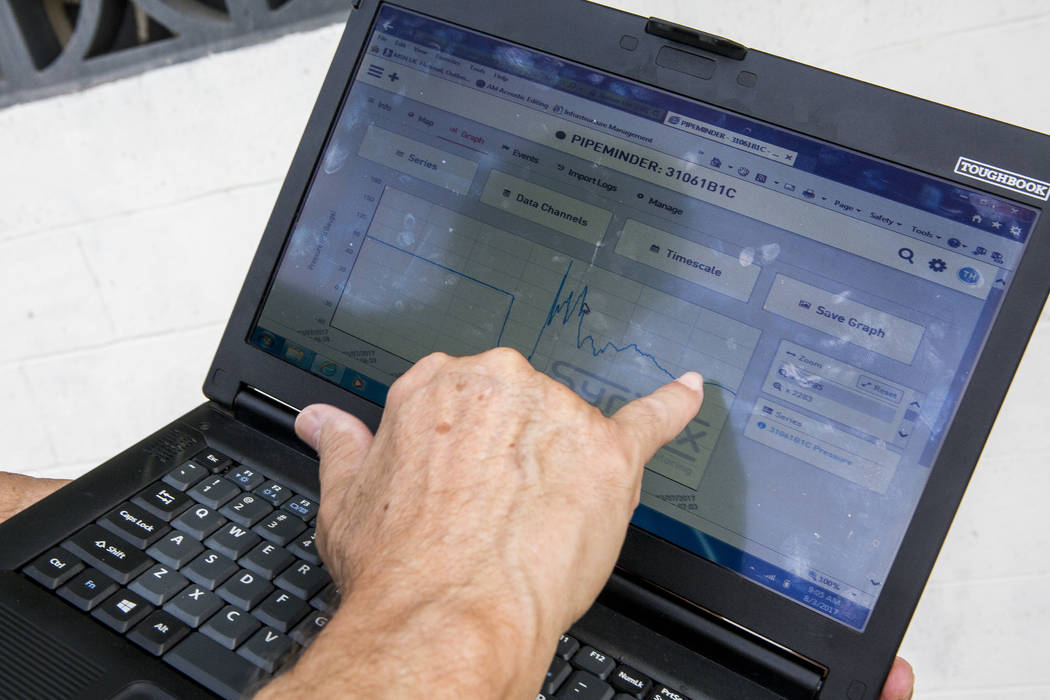 Lyle Mariam, a mechanical engineer with the Las Vegas Valley Water District, shows data on a laptop from the district's newest technology, a water pressure recording system called Syrinix, at a hy ...