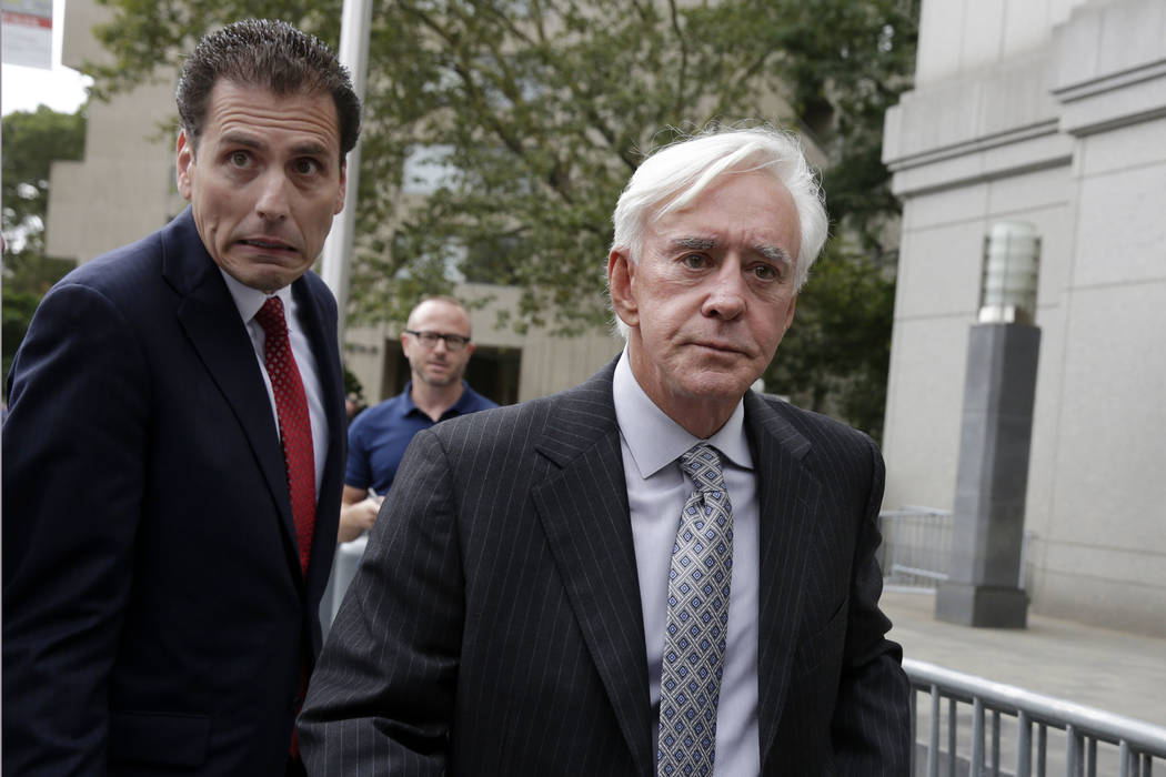 "Las Vegas gambler William ""Billy"" Walters, right, accompanied by one of his attorneys, leaves Manhattan federal court, in New York, Thursday, July 27, 2017. Walters, linked to go ..."
