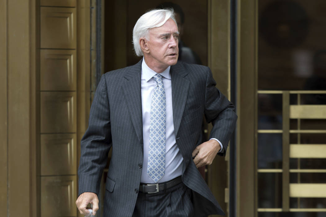"""Las Vegas gambler William """"Billy"""" Walters, right, leaves Manhattan federal court, in New York, Thursday, July 27, 2017. Walters, linked to golfer Phil Mickelson, was sentenced to ..."""