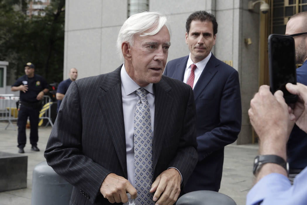 "Las Vegas gambler William ""Billy"" Walters, left,, accompanied by one of his attorneys, leaves Manhattan federal court, in New York, Thursday, July 27, 2017. Walters, linked to go ..."